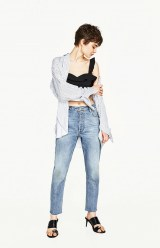 with boyfriend jeans and oversized shirt
